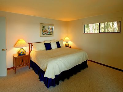 This cheerful king-bed room on the lower level has a view to the water and a patio.