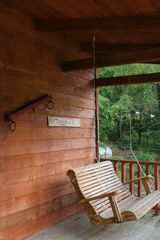 Relaxing back porch swing - Muddy Pond cabin vacation rental photo