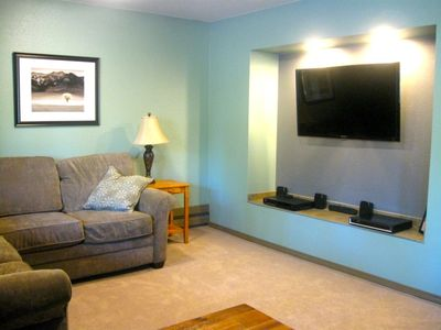 Living room showing flat panel TV & entertainment