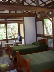 Montezuma bungalow photo - The bedroom with seating area. The upstairs opens up completely on 3 sides.