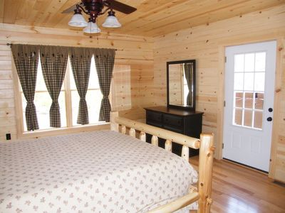 master bedroom with log bed and nature light with access to hot tub