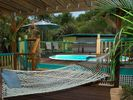 Hammocks Stretched Poolside - Coral Bay house vacation rental photo