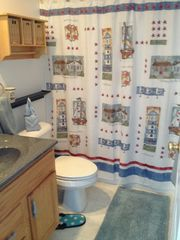 Manistee condo photo - Full bathroom with up north feel