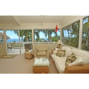 Sunroom with private lanai and 180 degree ocean views