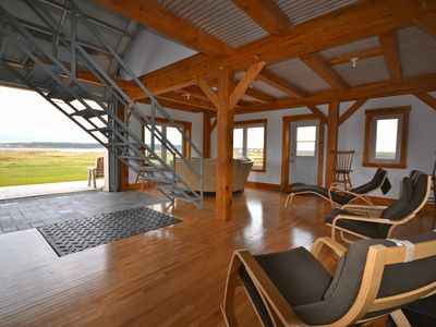 Cheticamp cottage rental - Living room facing the beach and island. With the 8' glass door wide open