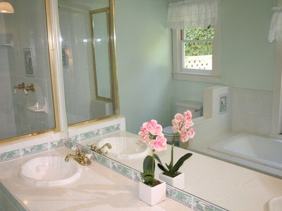 Custom tiled master bath, double vanity separate shower and jacuzzi tub