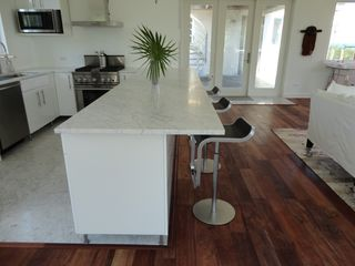 Governor's Harbour villa photo - Kitchen with all marble countertops and bar with stools and designer fixtures