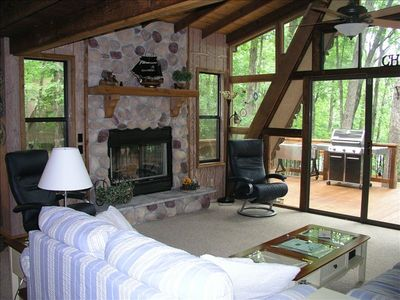 Living Room and Fireplace Look out onto Large Deck