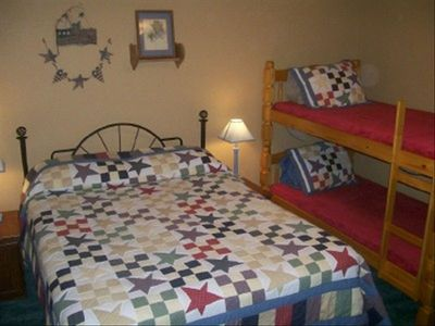 Ranch Second bedroom with queen bed and bunks