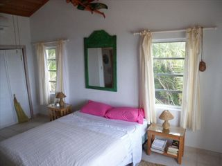 Rainbow Bay villa photo - Main bedroom with silk curtains, cotton sheets and Indonesian artwork