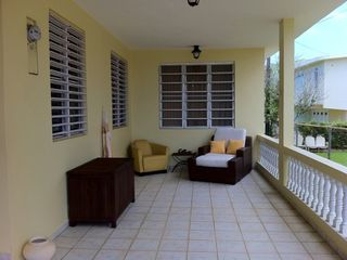 Aguadilla house photo - Enjoy a hammock in this sitting area. Chess is full of beach stuff.