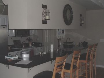 Gourmet kitchen with stainless appliances- snack bar with additional seating
