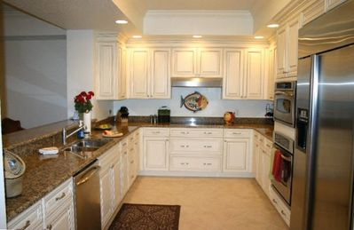 Kitchen with top of line GE Appliances and Marble counter-tops