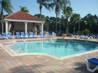 Emerald Island villa photo - Heated community pool at the clubhouse with fun tiki bar, hot tub, and sauna