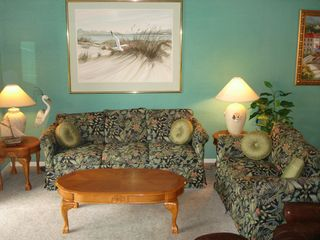 Living room with sleeper sofa - Destin condo vacation rental photo