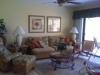 Living room with full-wall sliding doors - Siesta Key condo vacation rental photo