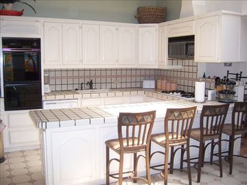 The upstairs kitchen has all major appliances and plenty of counter space.
