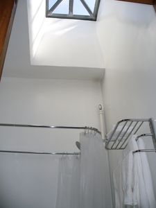 Harlem studio rental - Skylight in the bathroom keeps it bright.