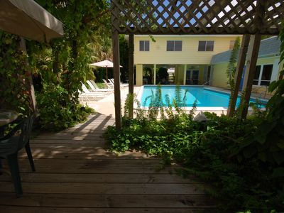Tropical, poolside front deck of 1BR Villa # 4