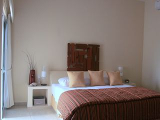 Akumal villa photo - The Main Floor Bedroom - king bed, private balcony, full bathroom & A/C.