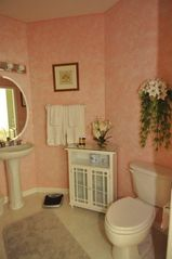 "Port St. Lucie condo photo - ""B"" Side Bathroom with Tub/Shower, Pedestal Sink"