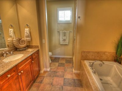 View of beautiful full size bathroom - notice the high end granite throughout.