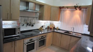 Kitchen with Fridge/freezer, microwave,kettle,toaster hob,2 ovens,dishwasher,etc