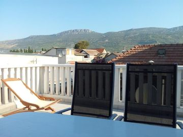 Relax on the roof terrace and enjoy the mountain views behind the property