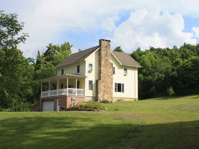 Renovated farmhouse on 10 serene acres with spring-fed pond and creeks