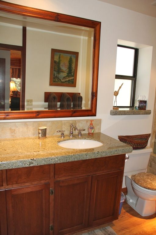 Lodge Master Suite: large vanity with hardwood floors