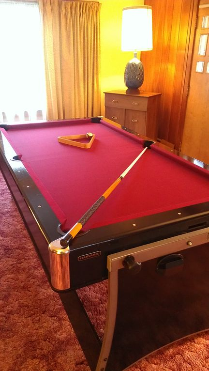 Pool/air hockey table in living room