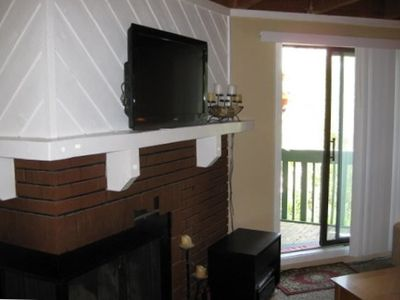Fireplace and Wall Mounted Flat Screen TV