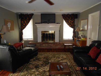Den with french doors. Brand new Hardwood floor. Large flat screen TV.