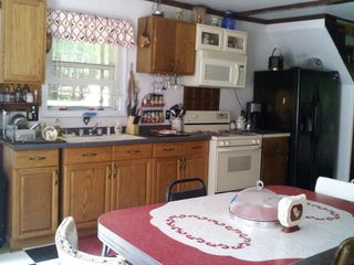 Moultonborough cottage photo - big eat in kitch with double door fridge with plenty of storage for food!!
