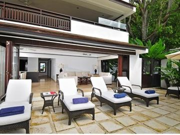 Large private patio leads directly to the beach