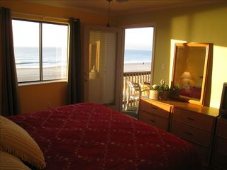 Ocean Drive Beach condo photo - Master BR with king bed, ceiling fan, TV, access to the balcony and ocean views!