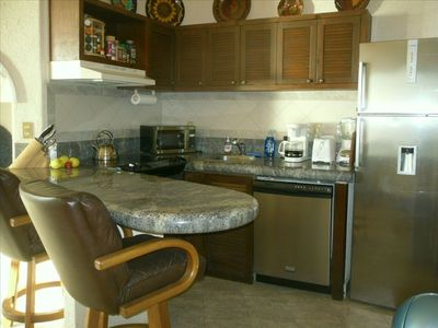 Fully equipped kitchen with new stainless steel appliances.
