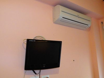 TV and air conditioning , in all bedrooms