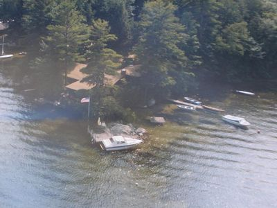 Aerial view of 16 Braun Bay Road Dock with rowboats not in-2nd dock left of flag