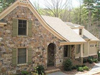 Big Canoe house photo - Beautiful wrap around stone work on front of house