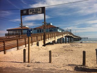 North Padre Island condo photo - Bob Hall Pier with fishing and restaurant about a mile down the beach.