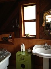 Breaux Bridge cottage photo - Cottage bathroom adjoins walk-in closet with plenty of hanging space & shelves.
