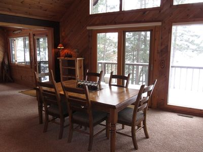 DR table off kitchen with lake views/ attached deck/additional island seating