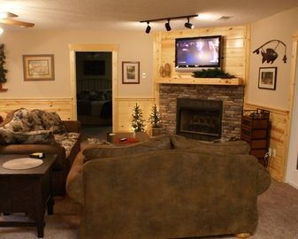 The family room features a queen sofa sleeper and gas fireplace