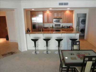 Open-plan kitchen, w/ laundry, foyer, HDTV, expanding dining table (8+)