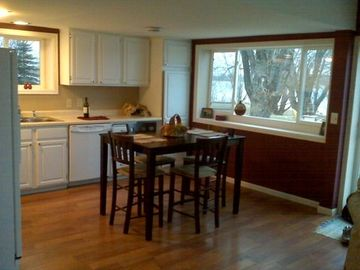 Spacious kitchen to cook in and enjoy the view of the lake
