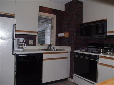 The Compact Kitchen is Fully Equipped and also Offers a Breakfast Bar