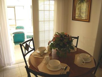 Breakfast nook leading out to the pool
