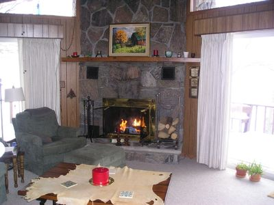 Living Room with fireplace & glass doors to deck