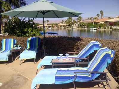 Relax in your lakefront lounge chair with a refreshment